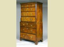 George I period walnut veneered chest on chest with inlaid starburst pattern, circa 1720