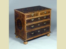 A William and Mary period olive and kingwood veneered chest of drawers