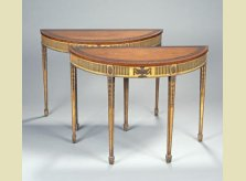 A pair of George III period gilded pier or demi-lune tables with satinwood tops