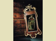 Early George III walnut and gilded pier glass mirror resting against a mahogany chest on chest