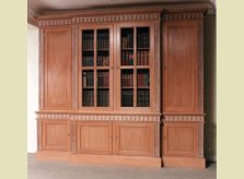 Bookcase with hand carved detail and wire mesh doors