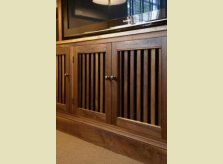 American Black Walnut cabinets concealing audio visual equipment