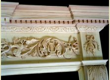 Work in progress on bespoke fire surround featuring carved instruments.
