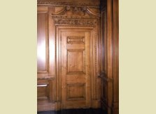 Cherry wood single door with detailed carved architrave and pediment