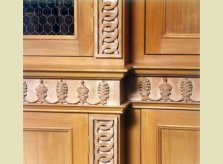 Detail of Hallidays' hand carving on bookcase