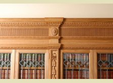 Detail of a heavily hand carved Oak bookcase