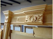 Detailed hand carving on an eight foot high mantelpiece waiting to be stained, polished and shipped to America