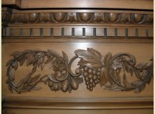 Detail of carved vine and foliage on special order mantelpiece