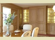 Pine panelled dining room with concealed wet bar, all stained to a custom colour by Hallidays' in house stainers