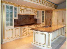Elaborately hand carved Halliday's kitchen with painted and gilded finish
