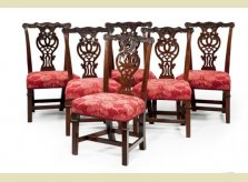 A set of six beautifully carved George II mahogany dining chairs, with unusual collars to legs. Circa 1750.