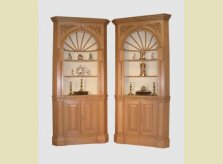 George III style corner cupboards with detailed carved spandrels