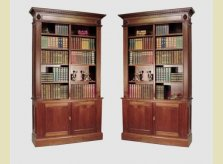 George III style open bookcases on cupboard bases