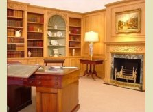 Georgian style panelled study with bookcases and display cabinets
