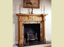 Grosvenor fire surround, the central urn flanked by swags and paterae