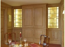 Hallidays' concealed pine bar with illuminated glass cabinets