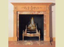 Hambledon fire surround with central carved urn and scrolling foliage