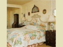 Elaborate hand carved and painted headboard and cornice