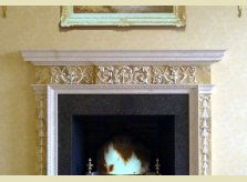 Hand carved Hallidays pine mantelpiece with marble paint effect