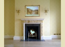 A Hallidays hand carved pine mantelpiece, painted with a marble paint effect