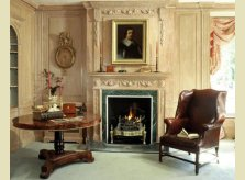 Limed pine panelled drawing room in the Georgian style with Hallidays Romney mantelpiece and Georgian firegrate