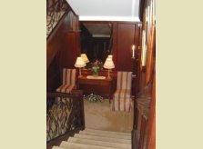 Mahogany (sapele) panelled hallway and staircase
