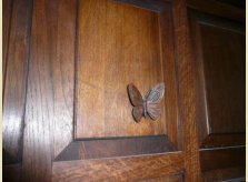 Medieval style oak panelling with raised butterfly