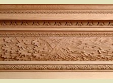 Oak leaf and acorn carving on an elaborate architrave