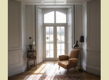 Painted panelled room with glazed doors