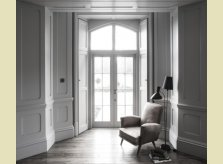 Panelled room by Hallidays with doorway to garden