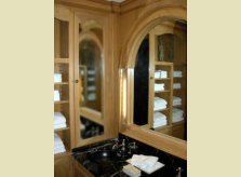 Pine panelled cloakroom with concealed lighting in hinged sections of mirror frame