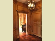 Pine panelled hallway and doors with carved architraves and pediment, Knightsbridge, London