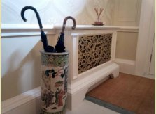 Radiator cover with bespoke brass grille