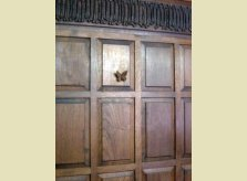 Raised butterfly on Oak panelling