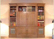 Stained pine bookcase with double doors concealing plasma TV