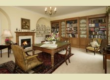 A Hallidays study with bookcases and Clarendon mantelpiece