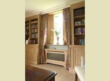 Pine study with bookcases, matching radiator covers and window shutters