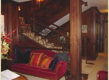 Sustainable mahogany (sapele) panelled hallway, stairs and lobby in an Iceland apartment