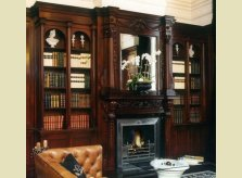 Victorian style sustainable mahogany (sapele) library bookcases with hand carved mantel and over-mantel