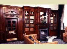 Victorian style sustainable mahogany (sapele) panelled sitting room with bookcases, by Hallidays UK