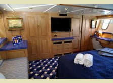 Hand waxed and polished interior for a private yacht by Hallidays, with sliding doors to bathroom