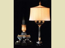 A pair of French Empire period bronze and gilded candelabra, now converted to lamps