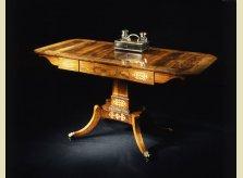 A barss inlaid Regency rosewood veneered sofa table with Regency coromandel inkstand