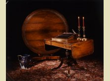 A Hallidays brass inlaid mahogany centre table, drop leaf sofa table, writing slope and decorative accessories