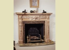 The heavily carved Pyrton mantelpiece with limed pine finish